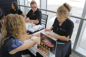 Guests enjoy treatments by Exhale Spa at The Opening Of The Centurion Lounge by American Express at Miami International Airport.