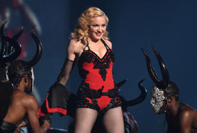 FILE - This Feb. 8, 2015 file photo shows Madonna performing at the 57th annual Grammy Awards in Los Angeles. Adi Lederman was sentenced Thursday to 14 months in prison after he was convicted of stealing and selling unreleased songs by.