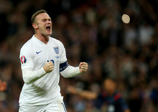 England's Wayne Rooney celebrates scoring his side's second goal of the game and his 50th international goal during the UEFA European Qualifying match at Wembley Stadium, London.
