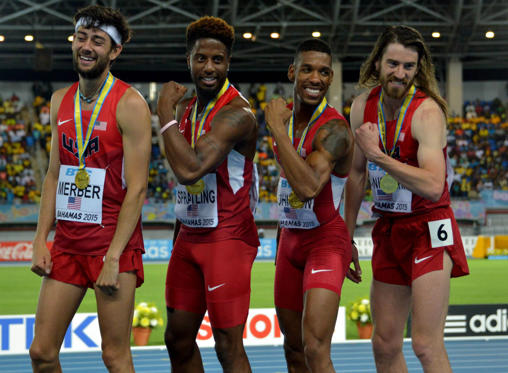Members of the United States distance medley relay pose with gold medals after setting a world record of 9:15.50 in the 2015 IAAF World Relays at Thomas A. Robinson National Stadium.