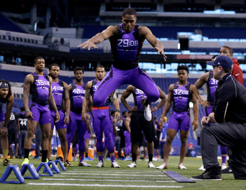 Connecticut defensive back Byron Jones runs a drill on the broad jump station at the NFL football scouting combine in Indianapolis, Monday, Feb. 23, 2015. Jones soared 12 feet, 3 inches in the broad jump, which was 15 inches farther than the second-best defensive back and 8 inches longer than the best listed in the NFL scouting combine database.