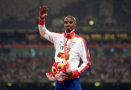 Great Britain's Mo Farah with his gold medal for the Men's 5000m during day eight of the IAAF World Championships at the Beijing National Stadium, China.