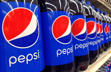 In this July 9, 2015, file photo, Pepsi bottles are on display at a supermarket in Haverhill, Mass. Pepsico reports quarterly financial results on Tuesday, Oct. 6, 2015.