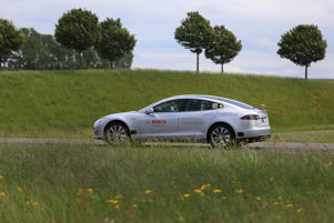A Tesla Motors Inc. Model S electric automobile fitted with Robert Bosch GmbH automated driving technology drives on a test track in Boxberg, Germany.