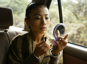 Actress Bai Ling applies makeup in her SUV. You will be able to touch up your makeup in driverless cars.