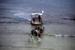 Tourists prepare to board a boat to snorkel in an area called the 'Coral Gardens' at Lady Elliot Island and 80 kms from the town of Bundaberg.
