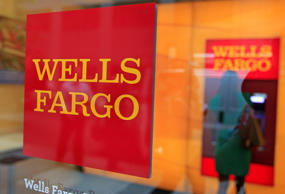 A Wells Fargo sign is seen outside a banking branch in New York in this July 13,...