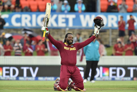 West Indies Chris Gayle celebrates his double century (200 runs) during the 2015 Cricket World Cup Pool B match between the West Indies and Zimbabwe at The Manuka Oval in Canberra on February 24, 2015.