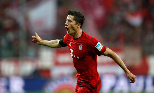 Robert Lewandowski of Bayern Munich celebrates after scoring his second goal during the Bundesliga match between FC Bayern Muenchen and VfL Wolfsburg at Allianz Arena on September 22, 2015 in Munich, Germany. (