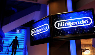 A man walks down stairs in the new store Nintendo World, in Rockefeller Plaza in New York Thursday, May 12, 2005. The store, which features interactive game kiosks with much of the company's newest hardware, is Nintendo's first-ever retail store.  (AP Photo/Gregory Bull)