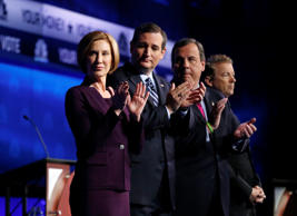 Republican presidential candidates, from left, Carly Fiorina, Ted Cruz, Chris Christie, and Rand Paul take the stage during the CNBC Republican presidential debate at the University of Colorado on Oct. 28, 2015, in Boulder, Colo.
