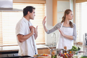 Couple arguing in the kitchen.