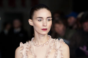 Rooney Mara poses for photographers upon arrival at the Premiere of the film Carol, showing as part of the London Film Festival, in central London, Wednesday, Oct. 14, 2015.