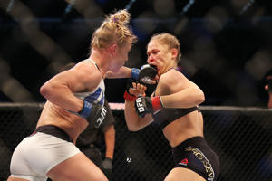 Ronda Rousey (R) and Holly Holm compete in their UFC women's bantamweight championship bout during the UFC 193 event at Etihad Stadium on November 15, 2015 in Melbourne, Australia.
