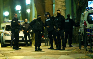 French special police forces secure the area during an operation to catch Paris attack fugitives in Saint-Denis