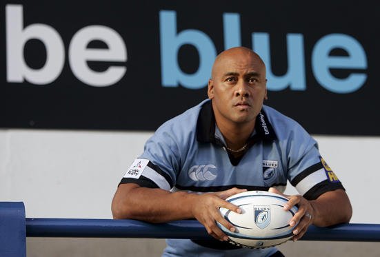 Cardiff Blues' new signing Jonah Lomu poses for photographers during a news conference in Cardiff, south Wales, November 14, 2005 file photo