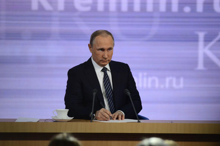 Russian President Vladimir Putin is seen during the 11th presidential annual news conference at the World Trade Center on Krasnaya Presnya on December 17, 2015.