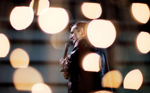 Republican presidential candidate, Sen. Ted Cruz, R-Texas, is seen through Christmas lights as he speaks during a campaign event Friday, Dec. 18, 2015, in Kennesaw, Ga. David Goldman/AP