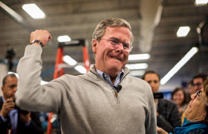 Republican candidate for president and former Governor of Florida Jeb Bush throws a fist in the air after hugging political activist Beverly Bruce at a town hall style meeting at Nashua Community College in Nashua, N.H., on Thursday, December 19, 2015. Melina Mara/The Washington Post/Getty Images
