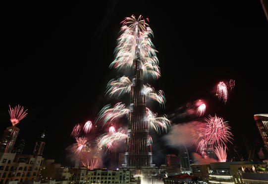 Fireworks explode from the Burj Khalifa, the world's tallest tower, in Dubai on January 1, 2014 to celebrate the new year. Dubai kicked off New Year with a dazzling bid for a new world record to cap those the Gulf city state already holds for its mammoth property developments. The glittering fireworks display that lasted around six minutes spanned over 100 kilometres (60 miles) of the Dubai coast, which boasts an archipelago of man-made islands and Burj Khalifa, the world's tallest tower. AFP PHOTO / STRINGER (Photo credit should read STRINGER/AFP/Getty Images)