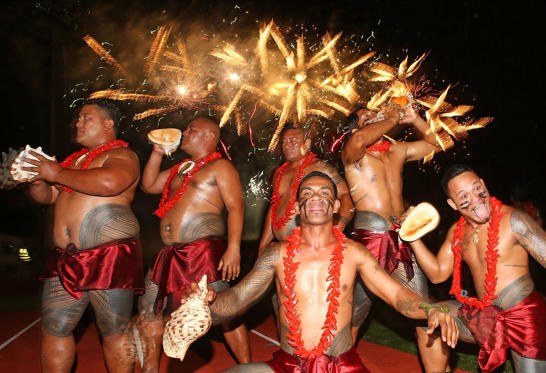APIA, SAMOA - SEPTEMBER 11: Samoan dancers perform as fireworks explode during the Closing Ceremony at the Apia Park Sports Complex on day five of the Samoa 2015 Commonwealth Youth Games on September 11, 2015 in Apia, Samoa. (Photo by Scott Barbour/Getty Images)