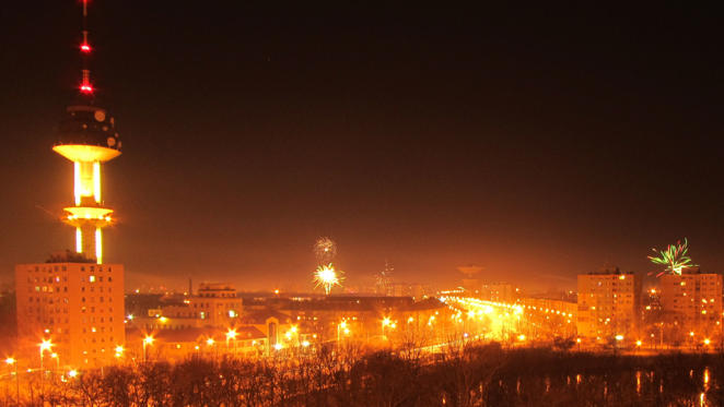 Fireworks and night cityscape of a suburb of Szeged, Hungary, New years eve