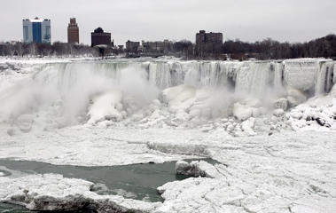 An ice filled Niagara Falls with the city of Niagara Falls, N.Y., in the background on Jan. 10, 2104.