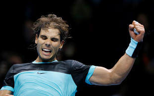 Rafael Nadal of Spain celebrates at match point after winning against Stan Wawrinka of Switzerland during their singles tennis match at the ATP World Tour Finals at the O2 Arena in London, Monday, Nov. 16, 2015.