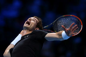 Andy Murray of Great Britain serves in his men's singles match against Rafael Nadal of Spain during day four of the Barclays ATP World Tour Finals at the O2 Arena on November 18, 2015 in London, England.