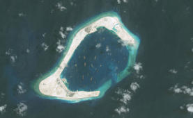 SUBI REEF, SOUTH CHINA SEA - SEPTEMBER 1, 2015: DigitalGlobe imagery of the Subi Reef in the South China Sea, a part of the Spratly Islands group. Image progression.