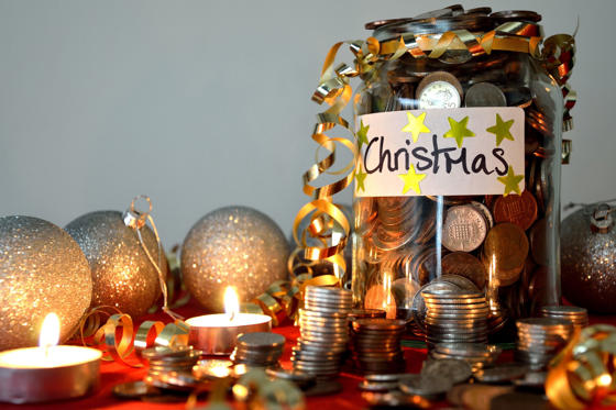 Slide 1 of 24: Jar of coins & Christmas ornaments