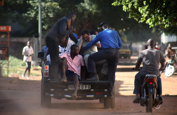 Malian security forces evacuate hostages freed from the Radisson Blu hotel in Bamako on November 20, 2015.