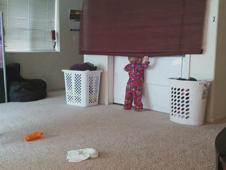 Super baby disappears behind curtain