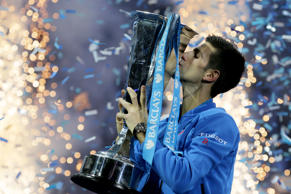 Novak Djokovic of Serbia kisses he winners trophy after he defeated Roger Federer of Switzerland in their singles final tennis match at the ATP World Tour Finals, in the O2 arena in London, Sunday Nov. 22, 2015