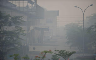Thick and smelly haze shrouds the city of Banjarmasin in South Kalimantan provin...