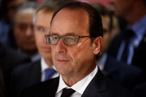 File: Francois Hollande, France's president, visits the French automobile manufacturers stands at the Paris Motor Show on the final preview day in Paris, France, on Friday, Oct. 3, 2014.