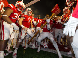 "Only in college football is the sight of wild-eyed, screaming young males wielding a 6-foot axe a joyous one. Paul Bunyan's Axe is simply a great trophy, as is the winner's ritual of ""chopping down"" the goal posts. Prior to the Axe's debut in 1948, the Badgers and Gophers played for the Slab of Bacon, a block of wood that displayed a W or an M (depending on how it was positioned) and emblazoned with the word 'bacon' twice. The winner would literally bring home the bacon."