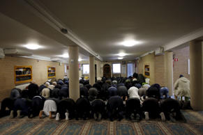 Members of the Muslim community attend the Friday prayer at Attadamoun Mosque in the neighbourhood of Molenbeek, in Brussels, Belgium, November 20, 2015.