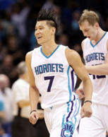 Charlotte Hornets' Jeremy Lin (7) reacts after a play against the Sacramento Kin...