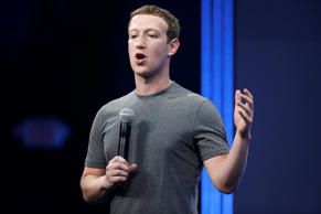 Facebook CEO Mark Zuckerberg gestures while talking during the Facebook F8 Developer Conference on March 25, 2015, in San Francisco.