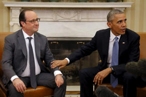 U.S. President Barack Obama meets with France's President Francois Hollande at the Oval Office of the White House in Washington.