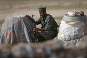 A soldier from the Syrian Democratic Forces takes cover on the frontline with ISIL on November 11, 2015 near Hasaka, in the autonomous region of Rojava, Syria. The armed forces of the mostly Kurdish region in northern Syria have been retaking territory from ISIL extremists with the help of airstrikes from U.S. led coalition warplanes.