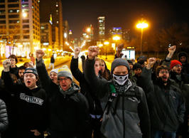 Demonstrators chant as the walk the streets during protests in Chicago, Illinois November 24, 2015 reacting to the release of a police video of the 2014 shooting of a black teenager, Laquan McDonald, by a white policeman, Jason Van Dyke. Van Dyke was charged with murder in the incident.
