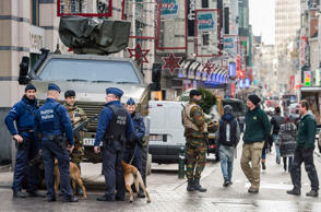 Belgian Army soldiers and Belgian police patrol a shopping street in the center of Brussels on Wednesday, Nov. 25, 2015. Students in Brussels have begun returning to class after a two-day shutdown over fears that a series of simultaneous attacks could be launched around the Belgian capital. Underground transport in Brussels is also slowly starting up again after a four-day closure.