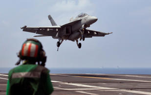 File photo of a U.S. Navy fighter jet approaching to land on the aircraft carrier USS Theodore Roosevelt.