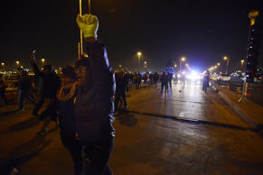 Protesters march during a protest for 17-year-old Laquan McDonald Tuesday, Nov. ...