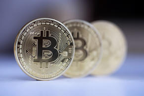 Three Bitcoins stand in this arranged photograph in Danbury, U.K., on Thursday, Dec. 10, 2015.