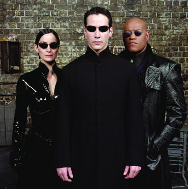 Slide 1 of 20: The Matrix Reloaded - 2003 Carrie-Anne Moss, Keanu Reeves and Laurence Fishburne