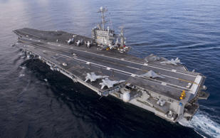 In this handout from the U.S. Navy the aircraft carrier USS Harry S. Truman is seen on December 9, 2012 in the Atalntic Ocean.