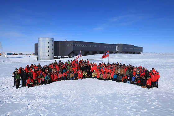 Norwegian Prime Minister Jens Stoltenberg and employees pose at outisde the Amundsen-Scott research base on the South Pole on December 12, 2011.